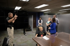 Constituent Kaley Bastine joins Senator Lindsey Williams for a tour of the Capitol Police facility. Kaley has raised over $10,000 for the Harrison Police Department in 2019.
