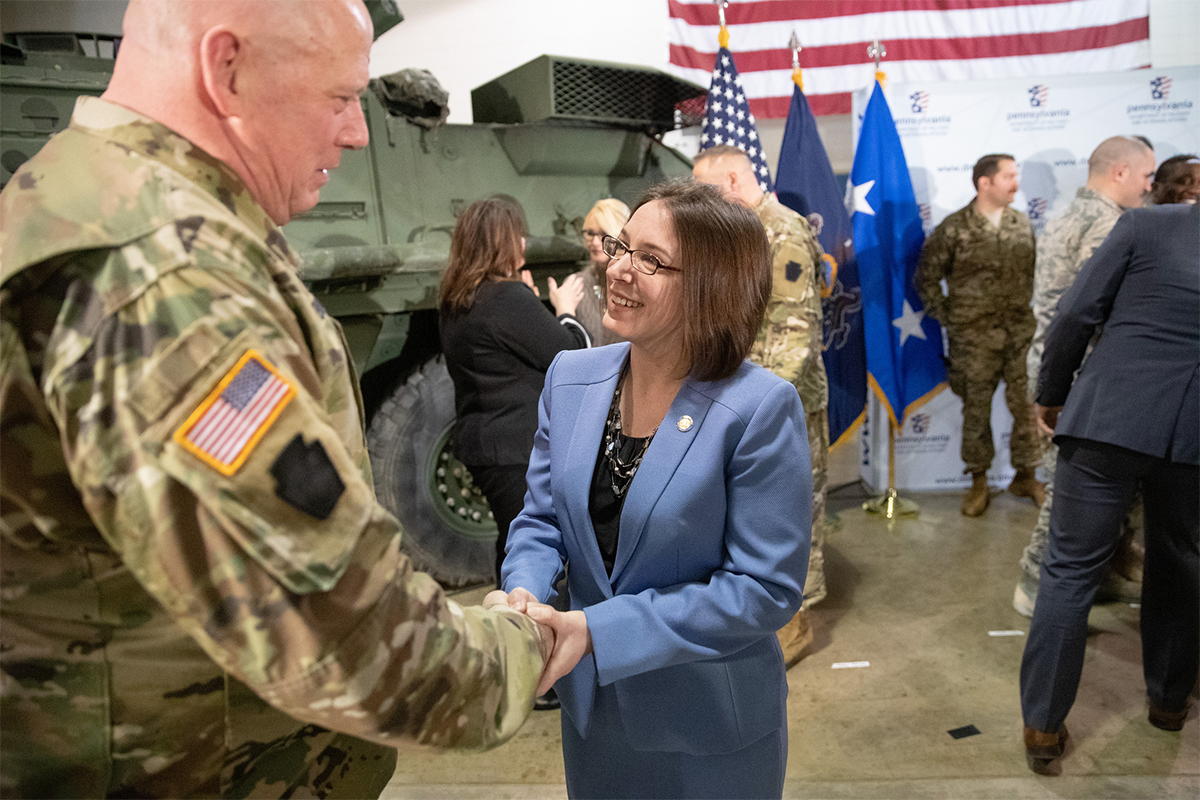 Senator Williams shakes hands with National Guard officer